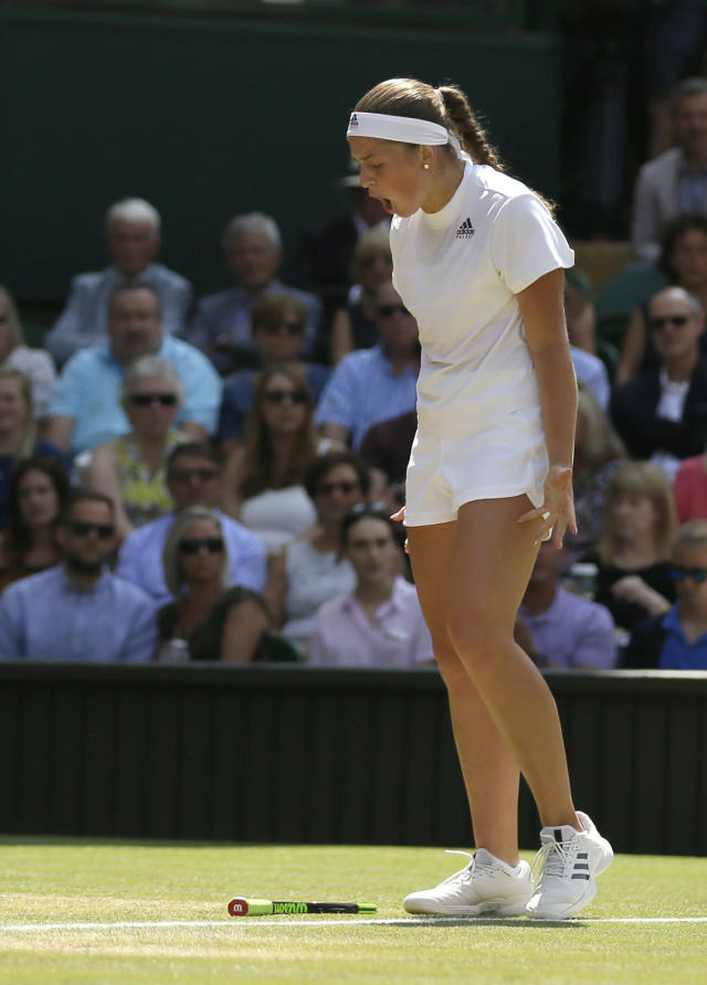 Latvia's Jelena Ostapenko reacts after losing a point to Germany's Angelique Kerber during their women's singles semifinals match at the Wimbledon Tennis Championships, in London, Thursday July 12, 2018. (AP Photo/Tim Ireland)