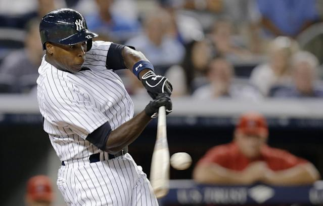 New York Yankees' Alfonso Soriano hits a fifth-inning, two-run home run in a baseball game against the Los Angeles Angels, Tuesday, Aug. 13, 2013, in New York. (AP Photo/Kathy Willens)