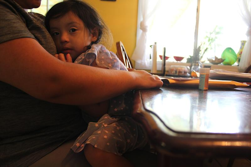 A woman who asked to be identified only by her first name, Ingrid, holds her 3-year-old daughter on Aug. 22, 2019. Ingrid's husband and his sister were detained during immigration raids in Mississippi on Aug. 7, 2019. Now Ingrid is the sole caretaker of nine children — six of them her own, three of them belonging to her sister-in-law, a single mother.