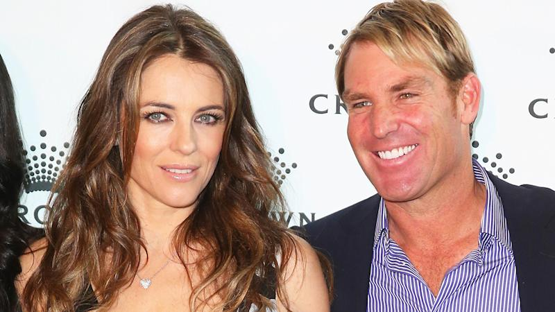 Elizabeth Hurley and Shane Warne are pictured in 2013.