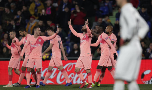 FC Barcelona's Lionel Messi celebrates after scoring during a Spanish La Liga soccer match between Getafe and FC Barcelona at the Alfonso Perez stadium in Getafe, Spain, Sunday, Jan. 6, 2019. (AP Photo/Manu Fernandez)