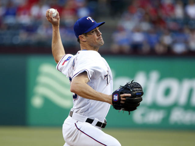 Texas Rangers starting pitcher Cole Hamels pitches against the Boston Red Sox during the first inning of a baseball game Saturday, May 5, 2018, in Arlington, Texas. (AP Photo/Michael Ainsworth)