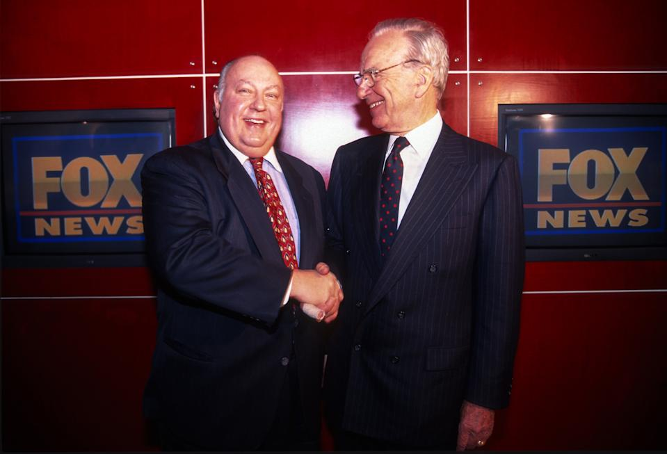 Rupert Murdoch shakes hands with Roger Ailes after naming Ailes the head of Fox News, New York, New York, January 30, 1996. (Photo by Allan Tannenbaum/Getty Images)
