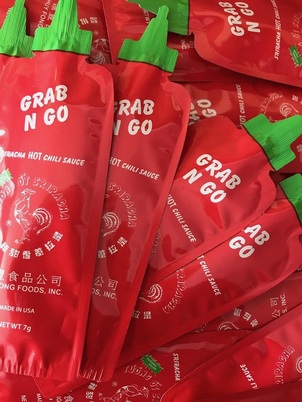 """<h3><a href=""""https://amzn.to/2XrJa0n"""" rel=""""nofollow noopener"""" target=""""_blank"""" data-ylk=""""slk:Huy Fong Grab N Go Sriracha Packets"""" class=""""link rapid-noclick-resp"""">Huy Fong Grab N Go Sriracha Packets</a></h3><br>Name one person who wouldn't want a packet of Sriracha <a href=""""https://www.youtube.com/watch?v=WDZJPJV__bQ"""" rel=""""nofollow noopener"""" target=""""_blank"""" data-ylk=""""slk:hot sauce in their bag"""" class=""""link rapid-noclick-resp"""">hot sauce in their bag</a>. We'll wait.<br><br><strong>Huy Fong</strong> Grab N Go Original Sriracha Chili Sauce (50 Pack), $, available at <a href=""""https://amzn.to/2XrJa0n"""" rel=""""nofollow noopener"""" target=""""_blank"""" data-ylk=""""slk:Amazon"""" class=""""link rapid-noclick-resp"""">Amazon</a>"""