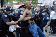 FILE — In this May 29, 2020 file photo, a protester is arrested during a rally at the Barclays Center, in the Brooklyn borough of New York, over the death of George Floyd, in Minneapolis. The New York Police Department was caught off guard by the size and scope of the spring protests sparked by the police killing of George Floyd in Minneapolis and resorted to disorder control tactics that stoked tensions and stifled free speech rights, the city's inspector general said in a report released Friday, Dec. 18, 2020. (AP Photo/Frank Franklin II, File)