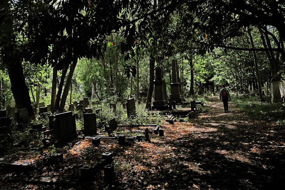 A woman walks through Tower Hamlets Cemetery Park in east London. (Photo by Yui Mok/PA Images via Getty Images)