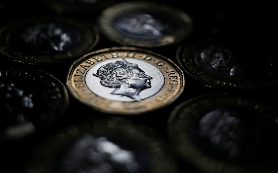 Pound coins are seen in the photo illustration taken in Manchester, Britain September 6, 2017. REUTERS/Phil Noble/Illustration