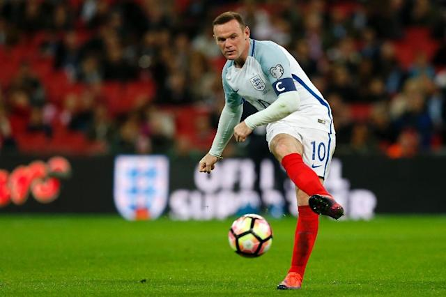 England's captain Wayne Rooney may well have to settle for a place among the substitutes again as United seek to deny Liverpool a victory (AFP Photo/Ian Kington)