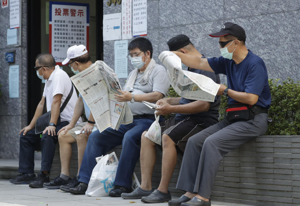 Members of the Nationalist Party, or KMT, wait to cast their ballot for the election of the party chairman at a polling station in Taipei, Taiwan, Saturday, Sept. 25, 2021. Fraught relations with neighboring China are dominating Saturday's election for the leader of Taiwan's main opposition Nationalist Party. (AP Photo/Chiang Ying-ying)