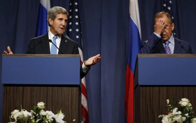 U.S. Secretary of State Kerry makes a point next to Russian Foreign Minister Lavrov as they speak to the media before their meeting in Geneva