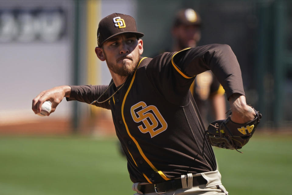 San Diego Padres' Joe Musgrove pitches in the first inning of a spring training baseball game against the Kansas City Royals, Monday, March 22, 2021, in Surprise, Ariz. (AP Photo/Sue Ogrocki)