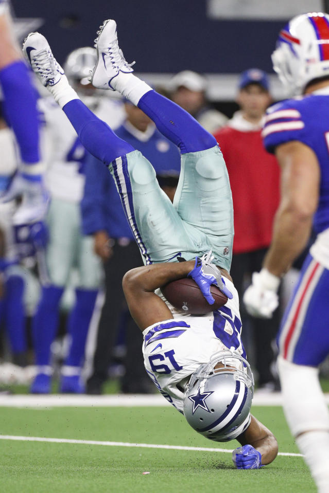 Dallas Cowboys wide receiver Amari Cooper (19) is upended after catching the ball during an NFL game against the Buffalo Bills, Thursday, Nov. 28, 2019 in Dallas. The Bills defeated the Cowboys 26-15. (Margaret Bowles via AP)