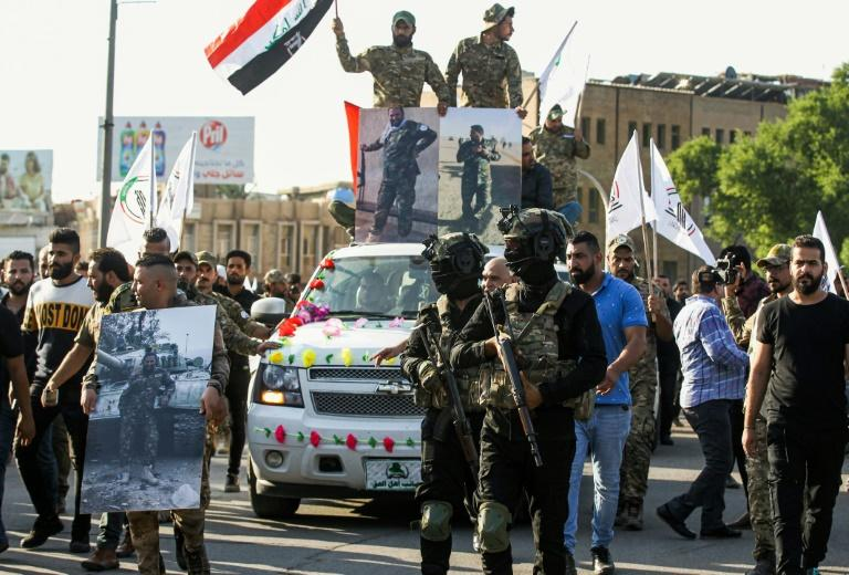 Members of the Hashed al-Shaabi paramilitary force take part in a funerary procession in the Iraqi capital Baghdad (AFP Photo/AHMAD AL-RUBAYE)