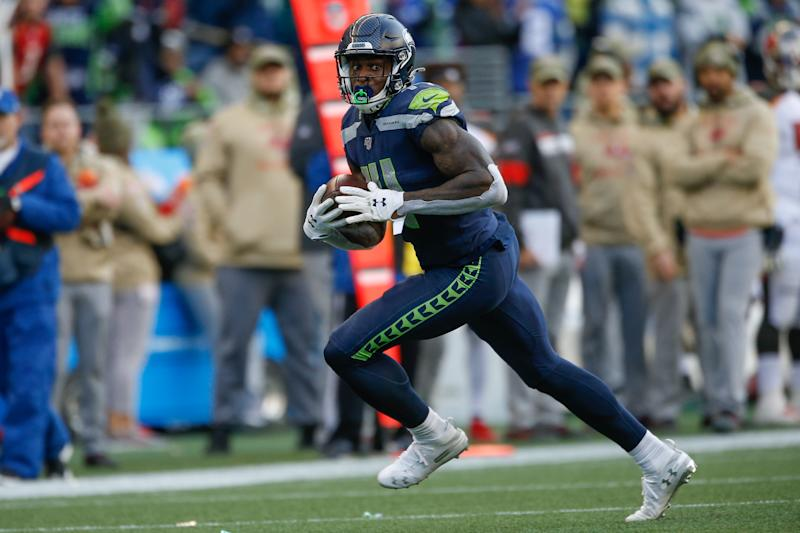 SEATTLE, WA - NOVEMBER 03: Wide receiver DK Metcalf #14 of the Seattle Seahawks rushes for a touchdown in the second half against the Tampa Bay Buccaneers at CenturyLink Field on November 3, 2019 in Seattle, Washington. The Seahawks beat the Buccaneers 40-34 in overtime. (Photo by Otto Greule Jr/Getty Images)