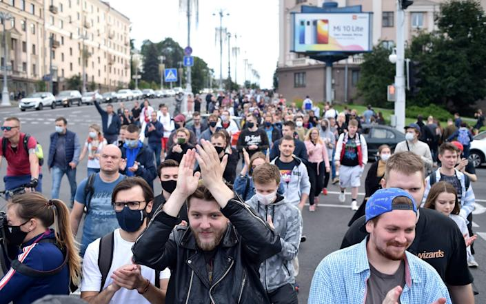 Protesters marched through central Minsk on Tuesday before violent detentions began - Sergei Gapon/AFP
