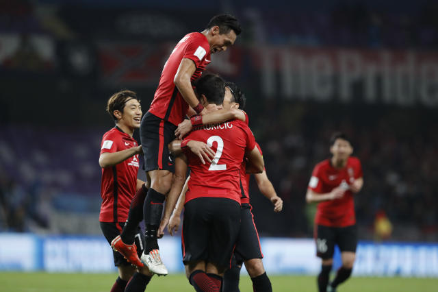 Japan's Urawa Reds Mauricio Antonio celebrates with teammates after scoring his side's third goal during the Club World Cup soccer match for the fifth place between Wydad Athletic Club and Urawa Reds at the Hazza Bin Zayed stadium in Al Ain, United Arab Emirates, Tuesday, Dec. 12, 2017. (AP Photo/Hassan Ammar)