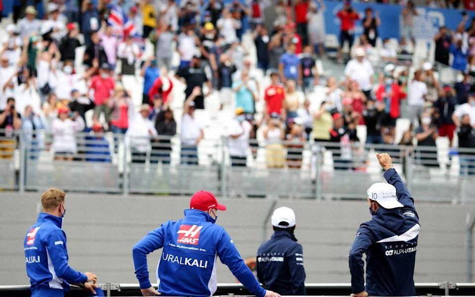 Pierre Gasly of France and Scuderia AlphaTauri (right) waves to the crowd from the back of a truck with Mick Schumacher of Germany and Haas F1, Nikita Mazepin of Russia and Haas F1 and Yuki Tsunoda of Japan and Scuderia AlphaTauri to show their appreciation to the fans prior to the F1 Grand Prix of France at Circuit Paul Ricard on June 20, 2021 in Le Castellet, France - Peter Fox/Getty Images