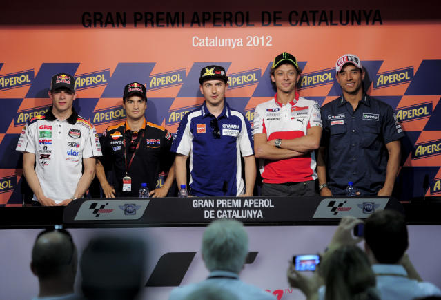 (FromL) LCR Honda MotoGP team's German Stefan Bradl, Repsol Honda Team's Spanish Jorge Lorenzo, Yamaha Factory Racing's Spanish Jorge Lorenzo, Ducati Team's Italian Valentino Rossi and Avintia Blusens team's Colombian Yonny Hernandez pose during a press conference at the Catalunya racetrack in Montmelo, near Barcelona, on May 31, 2012, on eve of the Catalunya Moto GP Grand Prix training sessions. AFP PHOTO / JOSEP LAGOJOSEP LAGO/AFP/GettyImages