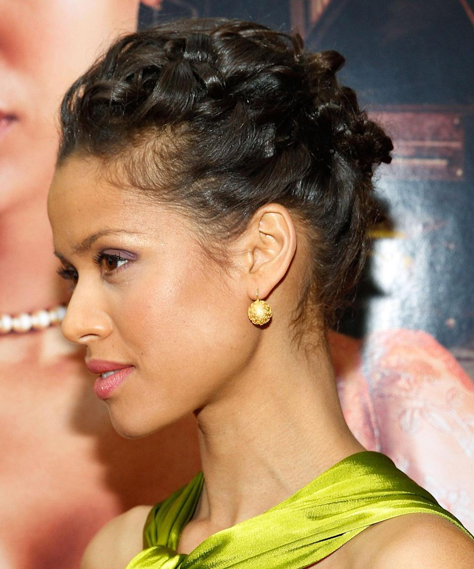 "<h3>Gugu Mbatha-Raw</h3> <br>The stunning English actress wears a French braid in an elevated updo.<span class=""copyright"">Photo: Mireya Acierto/FilmMagic.</span><br>"