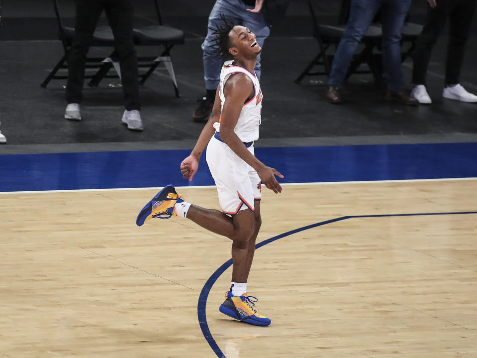 New York Knicks guard Immanuel Quickley (5) celebrates after making a 3-point basket against the Atlanta Hawks in overtime of an NBA basketball game Wednesday, April 21, 2021, in New York. (Wendell Cruz/Pool Photo via AP)