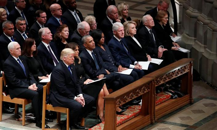 Donald Trump sits with first lady Melania Trump, former President Barack Obama, former first lady Michelle Obama, former President Bill Clinton and former first lady Hillary Clinton, former President Jimmy Carter and first lady Rosalynn Carter in the front row at the state funeral for former President George HW.Bush at the National Cathedral.