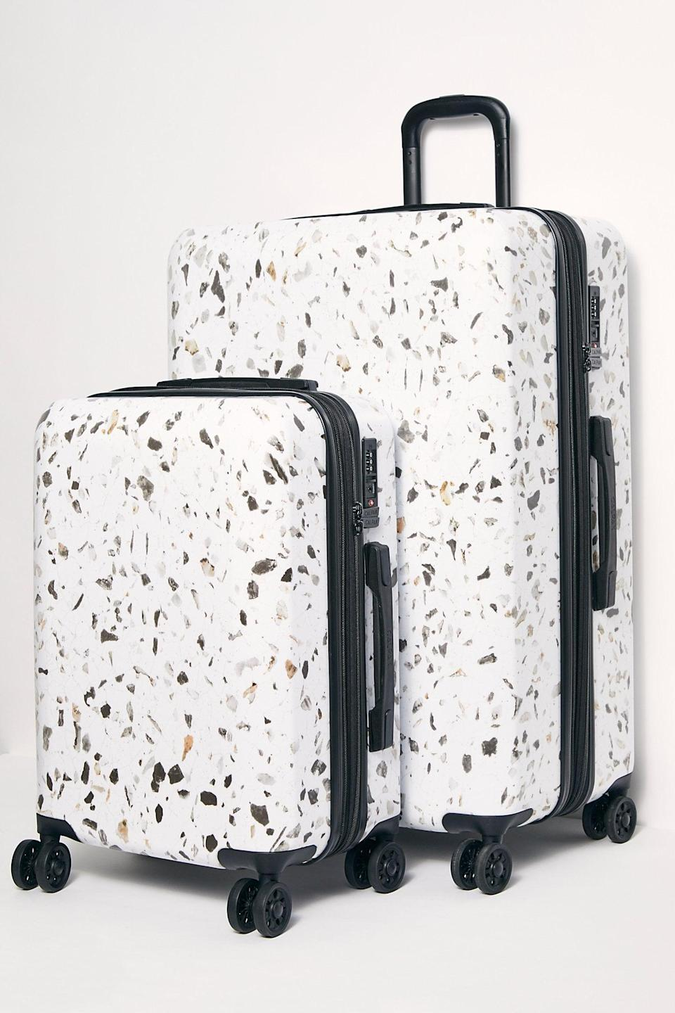 """<p>If they have an upcoming trip, get them this <a href=""""https://www.popsugar.com/buy/Calpak-Terrazzo-Two-Piece-Luggage-527157?p_name=Calpak%20Terrazzo%20Two-Piece%20Luggage&retailer=freepeople.com&pid=527157&price=325&evar1=fab%3Aus&evar9=45460327&evar98=https%3A%2F%2Fwww.popsugar.com%2Ffashion%2Fphoto-gallery%2F45460327%2Fimage%2F46978008%2FCalpak-Terrazzo-Two-Piece-Luggage&list1=shopping%2Cgifts%2Cfree%20people%2Choliday%2Cgift%20guide%2Cgifts%20for%20women&prop13=api&pdata=1"""" class=""""link rapid-noclick-resp"""" rel=""""nofollow noopener"""" target=""""_blank"""" data-ylk=""""slk:Calpak Terrazzo Two-Piece Luggage"""">Calpak Terrazzo Two-Piece Luggage</a> ($325) set.</p>"""