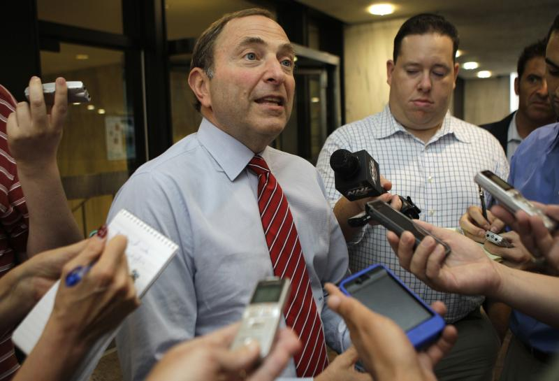 National Hockey League Commissioner Gary Bettman speaks to reporters about on going labor talks with the NHL Players Association outside the league's headquarters in New York, Tuesday, July 31, 2012. The current collective bargaining agreement ends on Sept. 15, and the NHL season is scheduled to open on Oct. 11. (AP Photo/Kathy Willens)