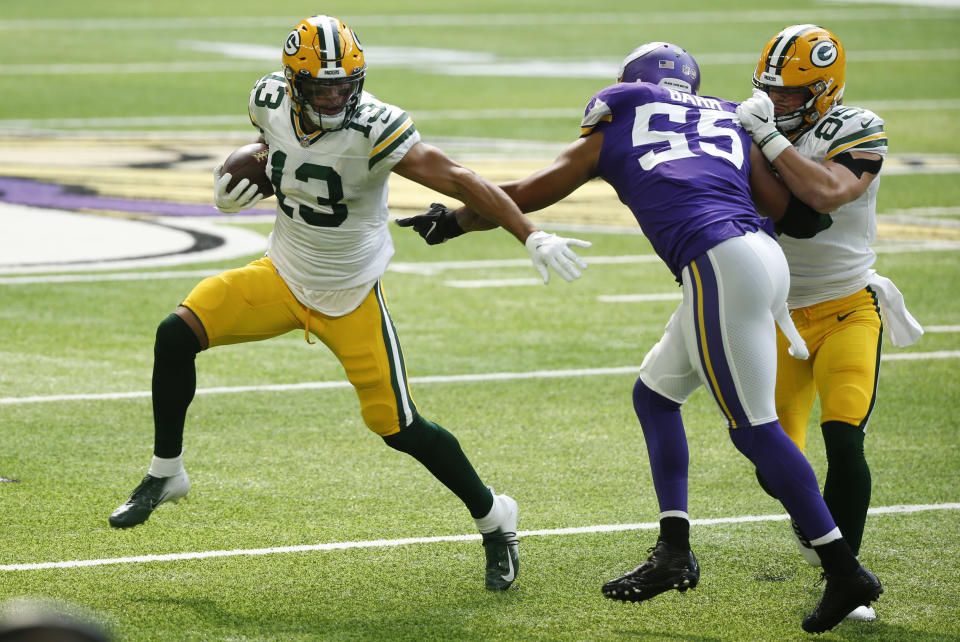 Green Bay Packers wide receiver Allen Lazard (13) runs from Minnesota Vikings outside linebacker Anthony Barr (55) during the first half of an NFL football game, Sunday, Sept. 13, 2020, in Minneapolis. (AP Photo/Bruce Kluckhohn)