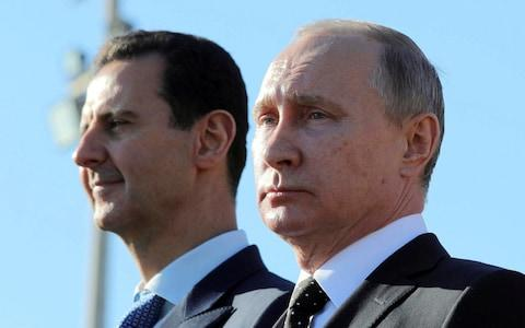 Russian President Putin and Syrian President Bashar al-Assad are long standing allies  - Credit: Sputnik Photo Agency/Reuters