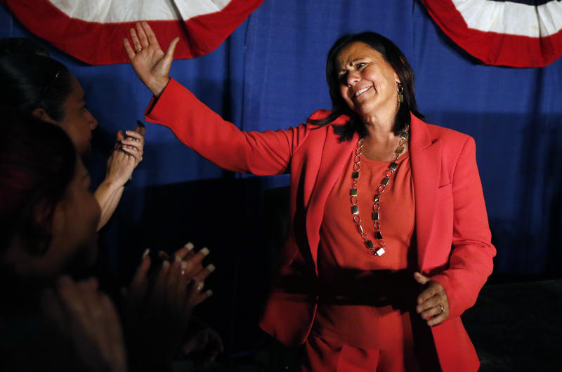 Democratic state Sen. Angela Giron waves to supporters as she gives her concession speech after she lost in a recall vote in Pueblo, Colo., Tuesday Sept. 10, 2013. Two Colorado state lawmakers who backed gun-control measures in the aftermath of the mass shootings in Colorado and Connecticut last year have been ousted in recall elections. (AP Photo/Brennan Linsley)