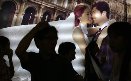People attend a wedding exhibition in downtown Shanghai June 16, 2013.