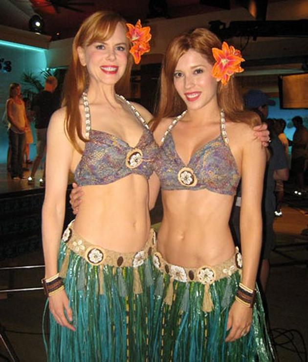 Alicia Vela-Bailey (right) filled in for Kidman and worked the grass skirt and bikini top.