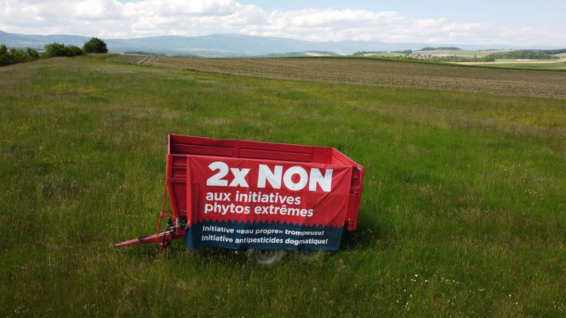 """A sign to vote """"no"""" is pictured ahead of a Swiss vote, in Penthaz"""