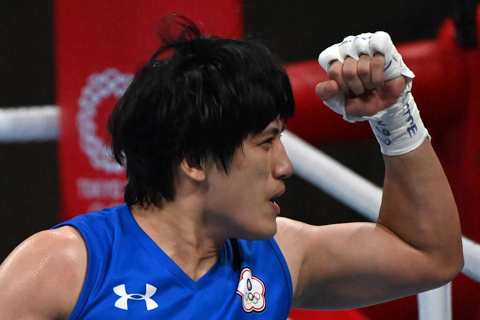 Chinese Taipei's Nien-Chin Chen celebrates after winning against Italy's Angela Carini at the end of their women's welter (64-69kg) preliminaries round of 16 boxing match during the Tokyo 2020 Olympic Games at the Kokugikan Arena in Tokyo on July 27, 2021.  / AFP / Luis ROBAYO