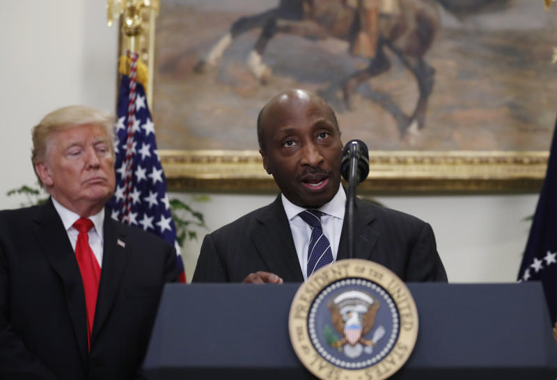 Ken Frazier, chairman and chief executive officer of Merck speaks, with President Donald Trump at left, during an event to announce a Merck, Pfizer, and Corning joint partnership to make glass containers for medication, in the Roosevelt Room of the White House, Thursday, July 20, 2017, in Washington. (AP Photo/Alex Brandon)