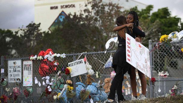 PHOTO: Tyra Heman, right, a senior at Marjory Stoneman Douglas High School, is hugged by Rachael Buto in front of the school where 17 people were killed in a mass shooting, Feb. 19, 2018 in Parkland, Fla. (Joe Raedle/Getty Images, FILE)