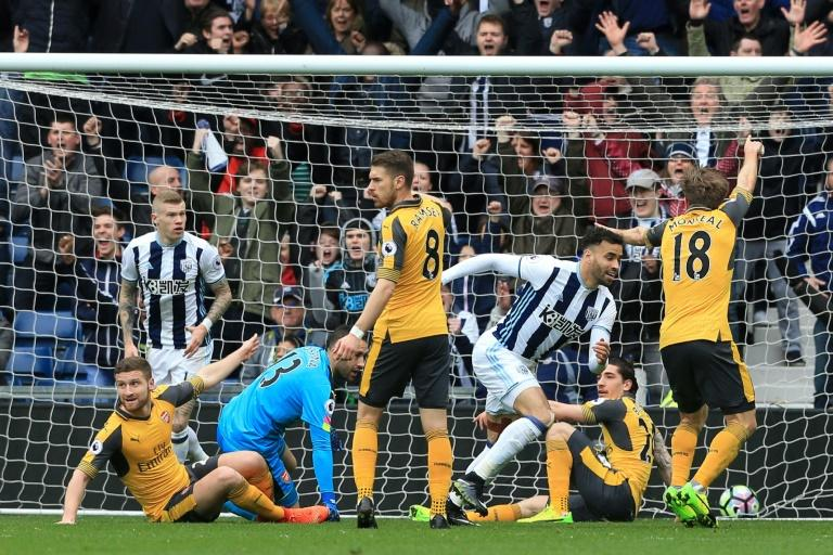 West Bromwich Albion's striker Hal Robson-Kanu (2R) scores past Arsenal's goalkeeper David Ospina during the English Premier League football match March 18, 2017