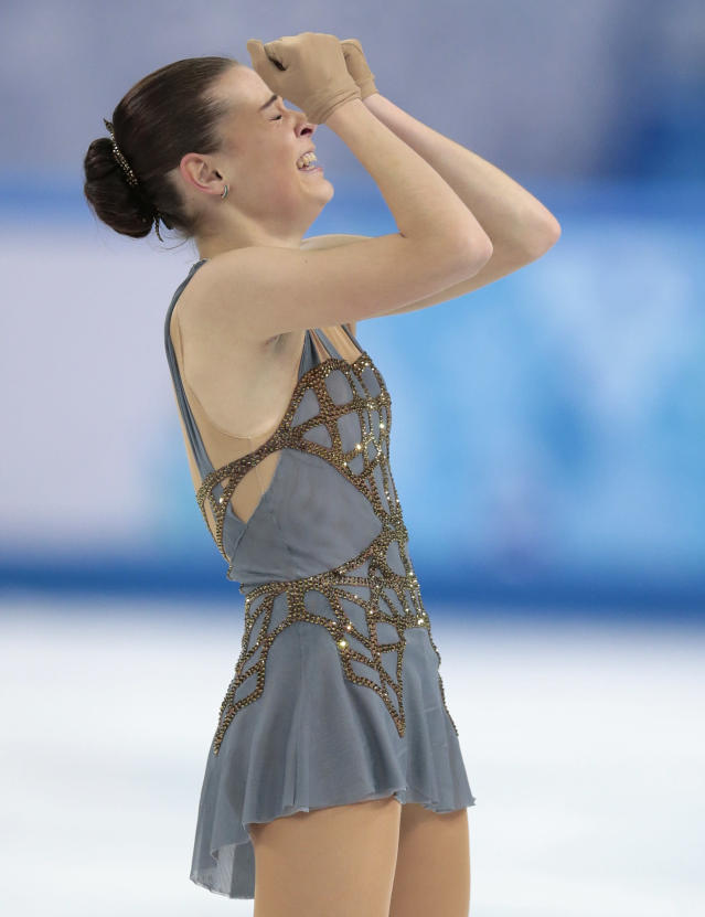 Adelina Sotnikova of Russia reacts after completing her routine in the women's free skate figure skating finals at the Iceberg Skating Palace during the 2014 Winter Olympics, Thursday, Feb. 20, 2014, in Sochi, Russia. (AP Photo/Ivan Sekretarev)