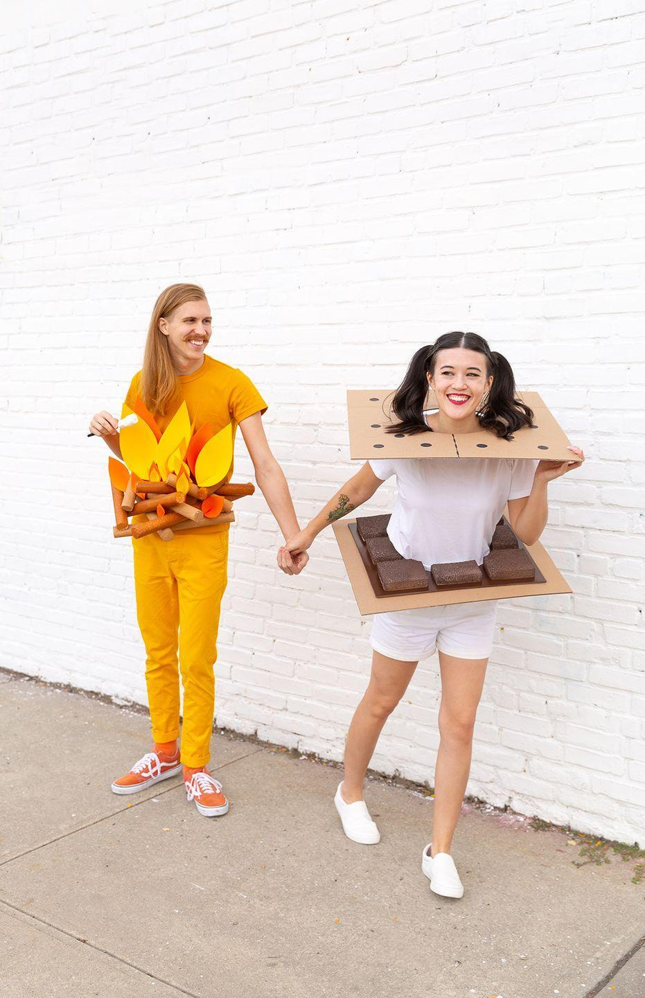 """<p>Good news: Creating this partner costume is surprisingly easy. The hardest part? Accepting the fact that the S'mores costume isn't edible. </p><p><em><a href=""""http://www.awwsam.com/2018/10/diy-camp-couples-costumes.html"""" rel=""""nofollow noopener"""" target=""""_blank"""" data-ylk=""""slk:Get the tutorial at Aww Sam >>"""" class=""""link rapid-noclick-resp"""">Get the tutorial at Aww Sam >></a><br></em></p>"""