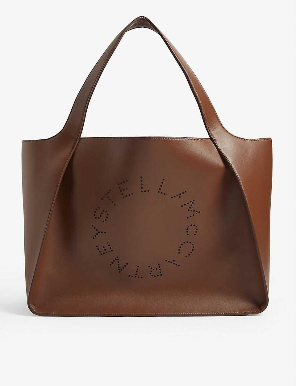 <p>If you're going to invest, you want to know it'll go with plenty of outfits in your closet. We also like that this <span>Stella McCartney Perforated Logo Faux Leather Tote</span> ($680) is vegan.</p>