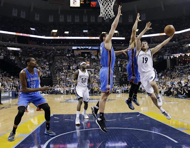 Memphis Grizzlies guard Beno Udrih (19) drives against Oklahoma City Thunder defenders Derek Fisher and Steven Adams, center, in the second half of Game 6 of an opening-round NBA basketball playoff series Thursday, May 1, 2014, in Memphis, Tenn. At left is Thunder forward Kevin Durant (35). Oklahoma City won 104-84 to even the series 3-3. (AP Photo/Mark Humphrey)