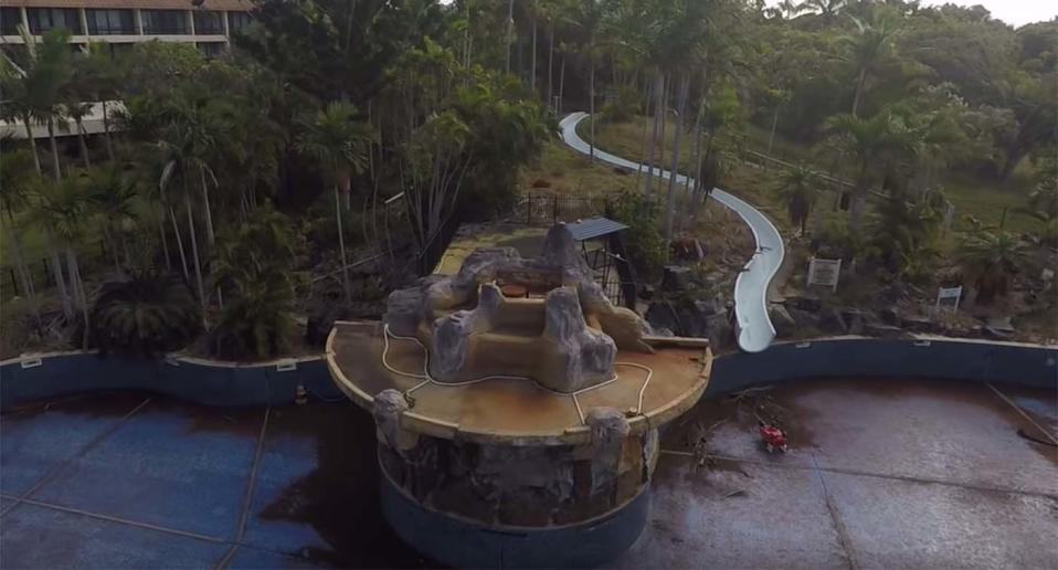 The abandoned swimming pool and water slide at the Capricorn Resort in Yeppoon.
