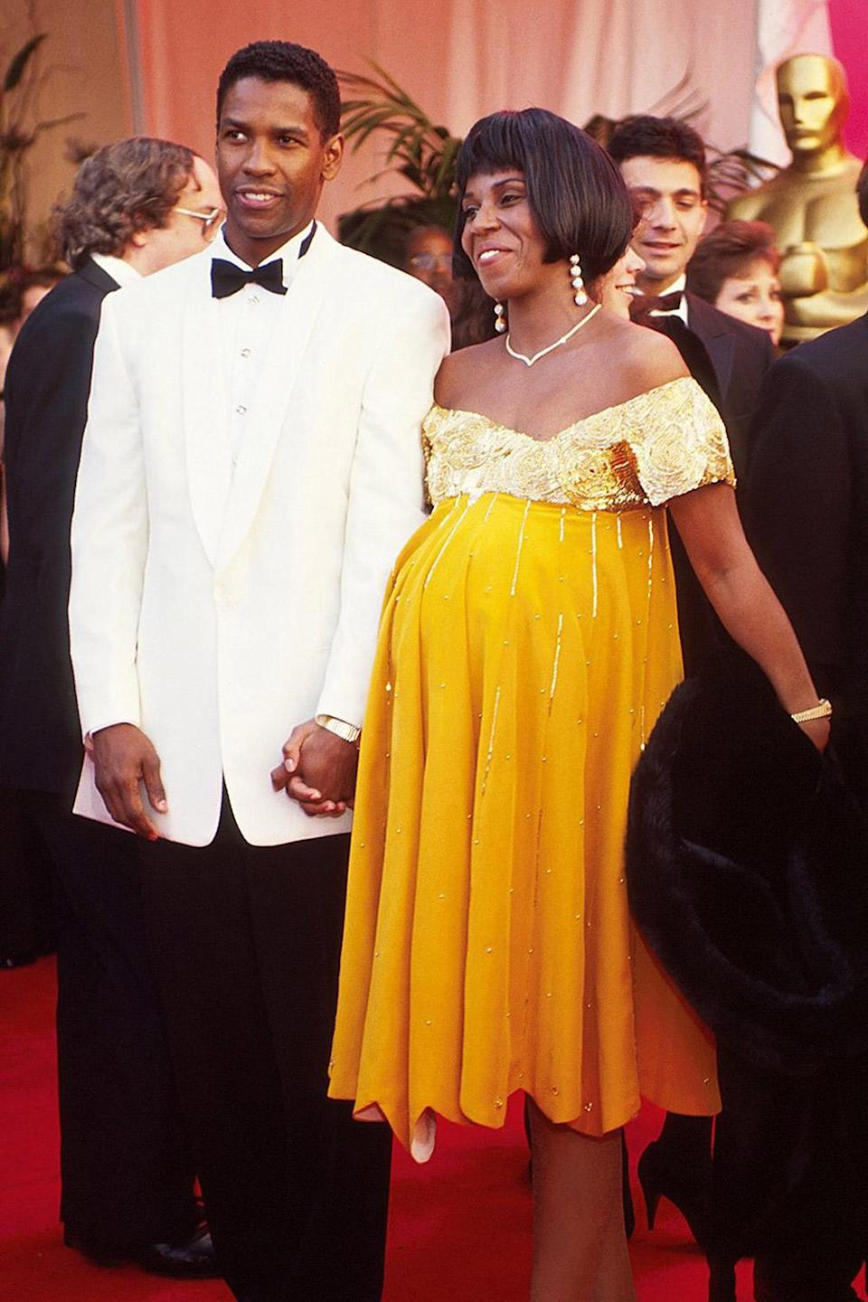 <p>Denzel Washington and his wife, Pauletta, then pregnant with their daughter Olivia, held hands while walking the carpet. </p>