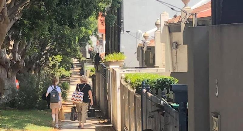 School girl pictured walking with lady she rushed to help with bags in Bondi Junction, Sydney.