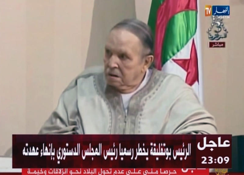 In this image from state TV broadcaster ENTV, Algerian President Abdelaziz Bouteflika, sitting in wheelchair, as he presents his resignation to president of Constitutional Council Tayeb Belaiz, during a meeting Tuesday April 2, 2019. Algerian President Abdelaziz Bouteflika stepped down on Tuesday after 20 years in office, following six weeks of massive nationwide public protests aimed at pushing him and his much-criticized inner circle from power in the gas-rich nation. (ENTV via AP)