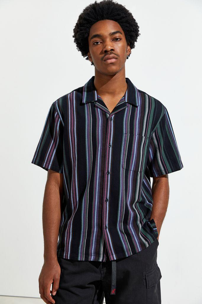 "A great gift for when it's time to give his trusty (read ""dusty"") T-shirt or hoodie a break. $49, Urban Outfitters. <a href=""https://www.urbanoutfitters.com/shop/without-walls-patterned-stripe-short-sleeve-button-down-shirt?color=009&type=REGULAR&quantity=1"" rel=""nofollow noopener"" target=""_blank"" data-ylk=""slk:Get it now!"" class=""link rapid-noclick-resp"">Get it now!</a>"