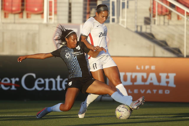 Sky Blue FC forward Midge Purce, left, and OL Reign forward Darian Jenkins (11) vie for the ball during the first half of an NWSL Challenge Cup soccer match at Zions Bank Stadium on Tuesday, June 30, 2020, in Herriman, Utah. (AP Photo/Rick Bowmer)