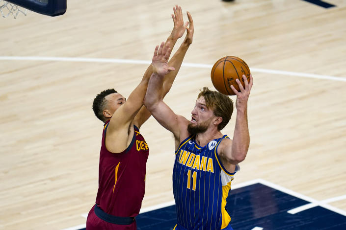 Indiana Pacers forward Domantas Sabonis (11) shoots over Cleveland Cavaliers guard Dante Exum (1) during the first half of an NBA basketball game in Indianapolis, Thursday, Dec. 31, 2020. (AP Photo/Michael Conroy)