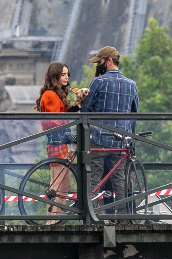 PARIS, FRANCE - JUNE 22: Actress Lily Collins and Charlie McDowell are seen on the set of 'Emily in Paris' Season II on June 22, 2021 in Paris, France. (Photo by Marc Piasecki/GC Images)