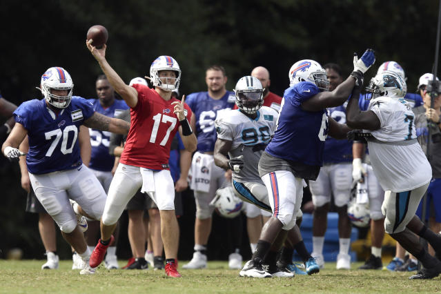 Buffalo Bills quarterback Josh Allen (17) passes against the Carolina Panthers during an NFL football training camp in Spartanburg, S.C., Wednesday, Aug. 14, 2019. (AP Photo/Gerry Broome)